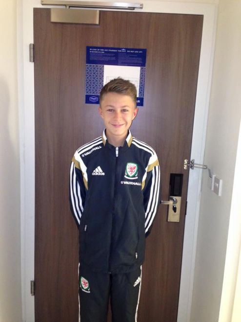 Dom in his Wales football tracksuit