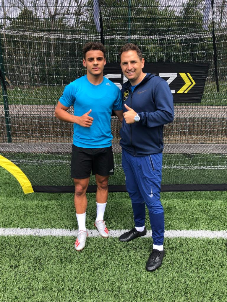 Coach Saul Isaksson-Hurst with Norwich's full-back Max Aarons